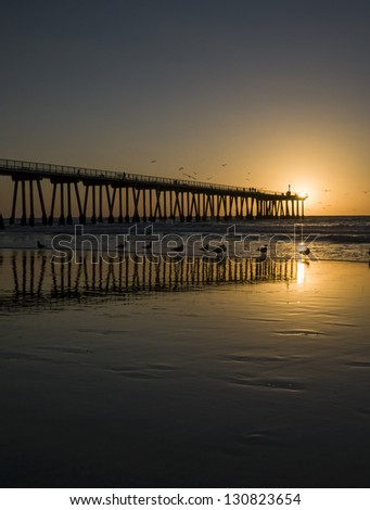 Hermosa Beach Pier Sunset Silhouette - stock photo