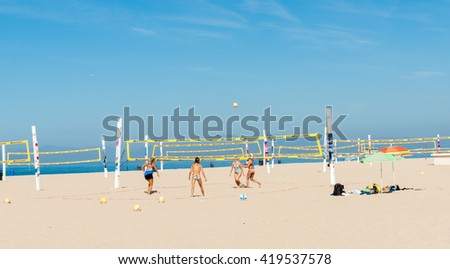 HERMOSA BEACH, USA - OCTOBER 8;Women tanned and fit playing Beach volleyball under Californian summer sky on October 8, 2015 Hermosa Beach, California, USA