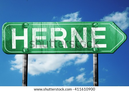 Herne road sign, 3D rendering, vintage green with clouds backgro