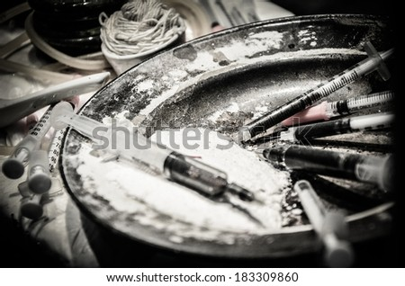 Heroin drug concept. White Heroin powder and needle. Vintage. - stock photo
