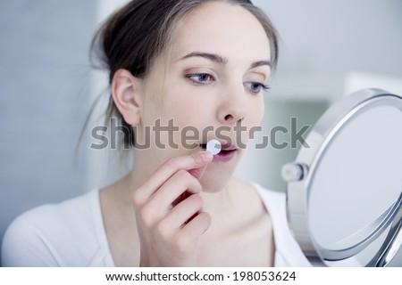 Herpes treatment - stock photo