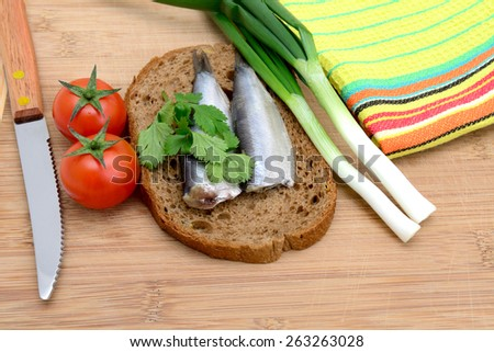 herring and green onion on a  bread - stock photo
