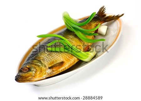 herring and green onion on a plate - stock photo