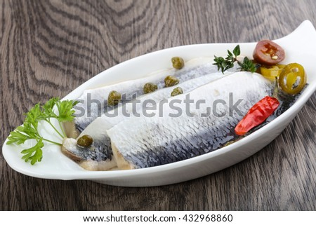 Herring fillet with capers, parsley and pepper