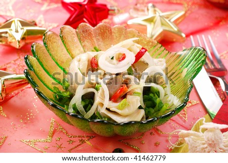 herring rolls  with chives and onion for christmas eve - stock photo