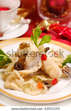 herring  salad with  olives and  onion on christmas table - stock photo