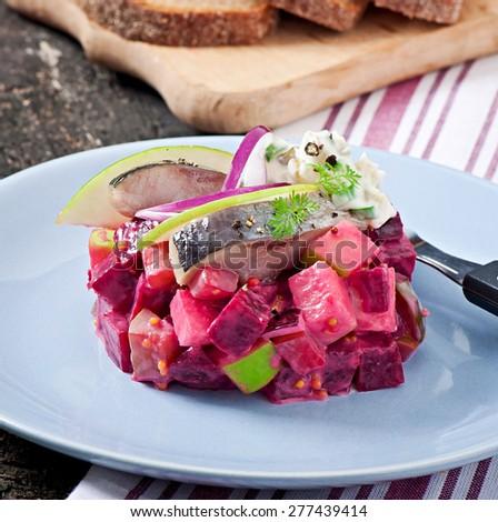 Herring salad with sour cream sauce - stock photo