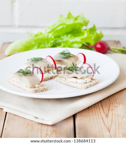 Herring Sandwiches  with ricotta cheese, radish and dill on toast