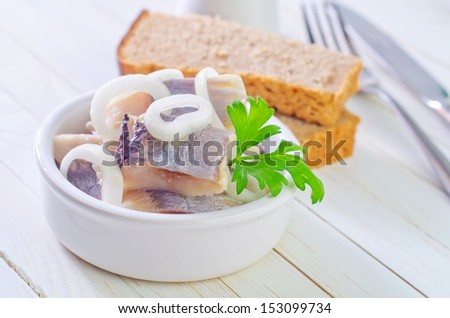 herring with onion and bread - stock photo