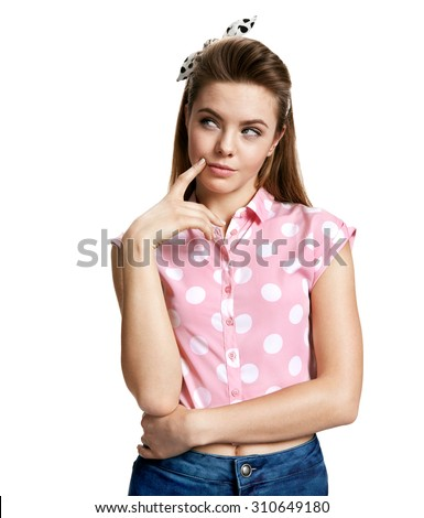 Hesitant girl thinking and looking towards / photo of young cheerful brunette woman over white background - stock photo