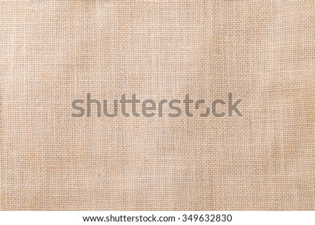 Hessian sackcloth woven texture pattern background in light cream beige brown color tone: Eco friendly raw organic flax cloth fabric textile backdrop: Bag rope thread detailed textured burlap canvas   - stock photo