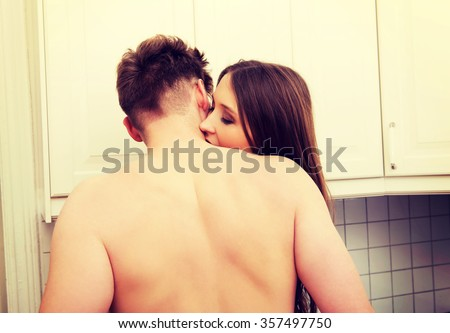 Heterosexual couple having sex in the kitchen. - stock photo