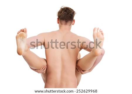 Heterosexual naked couple having sex. - stock photo