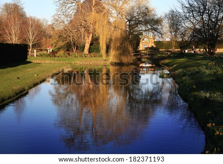 HEVER CASTLE AND GARDENS, KENT, UK - MARCH 10, 2014: River in 250 acre park. 13th century  Tudor manor