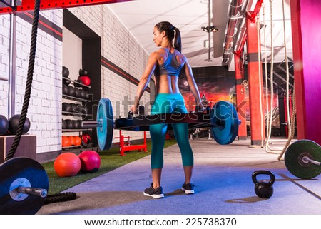 Hex Dead Lift Shrug Bar Deadlifts woman at gym workout weightlifting - stock photo