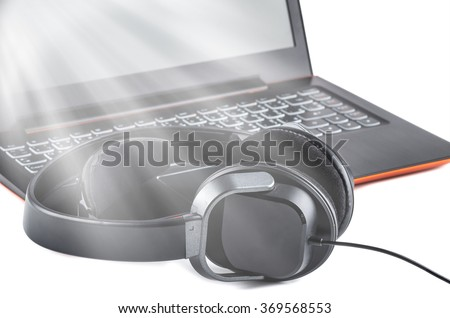 hi-fi headphones on a laptop in the studio, stereo headset with modern laptop isolated on white