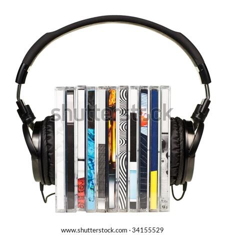 HI-Fi headphones on stack of CDs on white background - stock photo