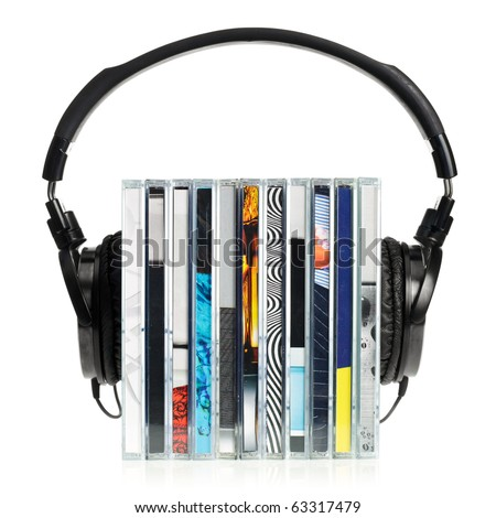 HI-Fi headphones on stack of CDs on white background - stock photo
