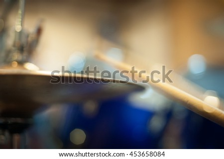 Hi hat cymbal detail golden metal with blurred effect of drum stick while hitting plate - stock photo