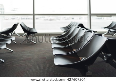 Hi-key business seats in the waiting hall at airport - stock photo
