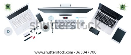 Hi-tech business desktop with computers set, digital tablet and smartphone, information technology and multiplatform concept, top view, white background - stock photo