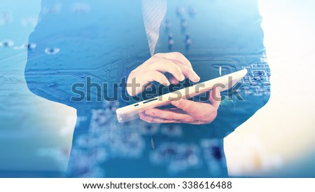Hi-tech concept, man using tablet on electronic background double exposure - stock photo
