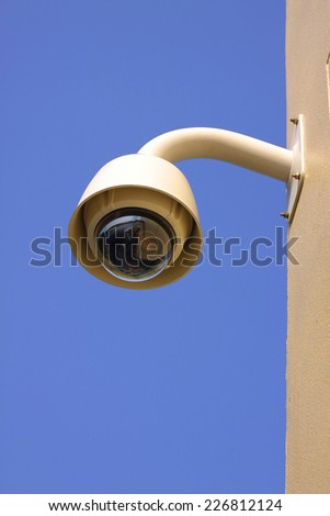 Hi-tech dome type camera on a wall