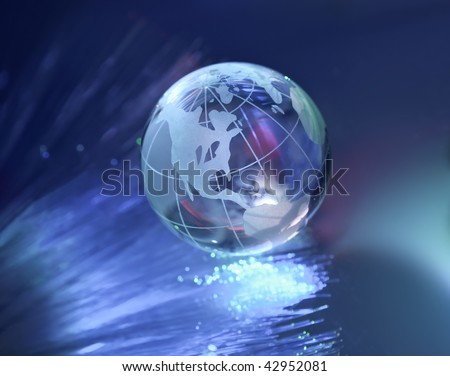 hi-tech earth globe against fiber optic background