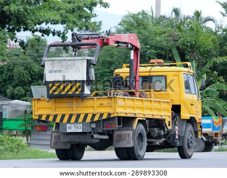 HIANGMAI , THAILAND -JUNE 23 2015:   Bucket truck of Department of Highways. Photo at road no.1001 about 8 km from downtown Chiangmai, thailand. - stock photo