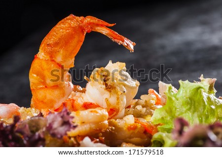 Hibachi rice with seafoods, prawns and lettuce - stock photo