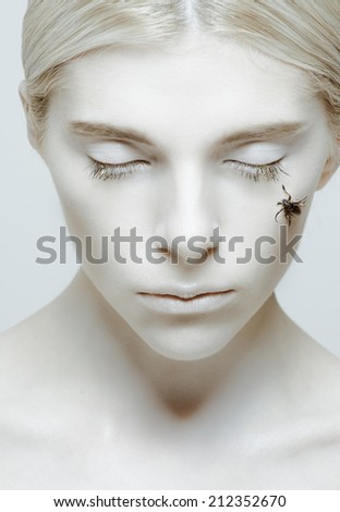 Hibernation and sleep: girl with closed eyes and insect on her cheek  - stock photo