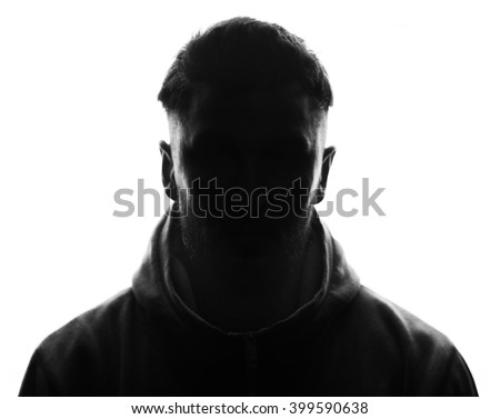 Hidden face in the shadow.male person silhouette. - stock photo