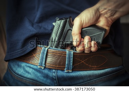 Hidden gun - stock photo