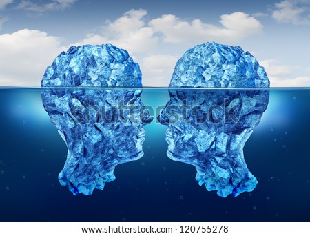 Hidden relationship and secret partnership as two icebergs shaped as human heads face to face concealed underwater as a clandestine meeting. - stock photo