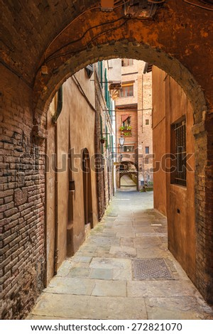 Hidden streets of the ancient city of Siena, Italy - stock photo