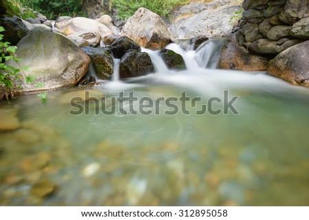 Hiden stream in spring - stock photo