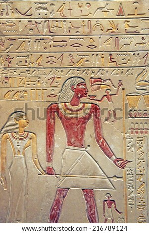 Hieroglyphic carving of Egyptians in color - stock photo