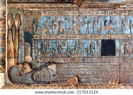 Hieroglyphic drawings and paintings on the ceiling and walls of the ancient Egyptian temple of Dendera - stock photo