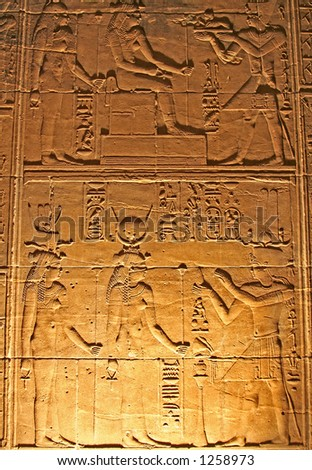 Hieroglyphics on the wall in the Temple of Philae at Aswan, Egypt (Low light photography)
