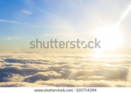 high above the sun and clouds - stock photo