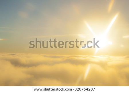 high above the sun and clouds