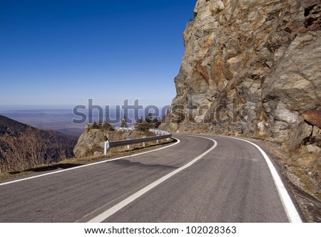 high altitude asphalt road with curve in mountain