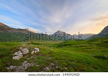 High altitude idyllic alpine landscape at sunset. Location: Col du Petit Mont Cenis, Savoie, France. - stock photo