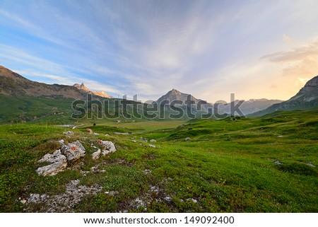 High altitude idyllic alpine landscape at sunset. Location: Col du Petit Mont Cenis, Savoie, France. - stock photo