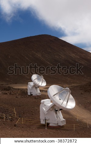 High altitude radio astronomy telescopes, part of the Sub-Millimeter Array, atop the summit of Mauna Kea volcano, Big Island, Hawaii - stock photo