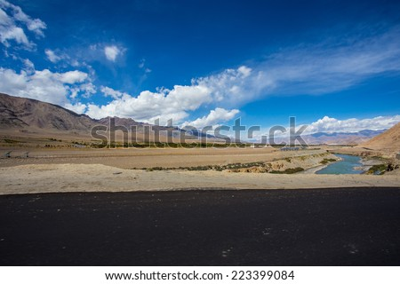 High altitude road in mountains - stock photo