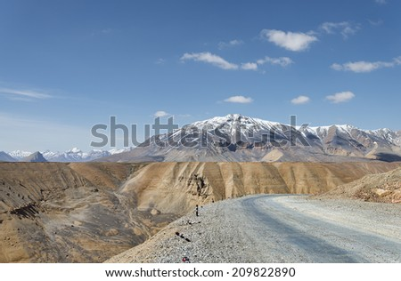 High altitude road with snow capped mountain background