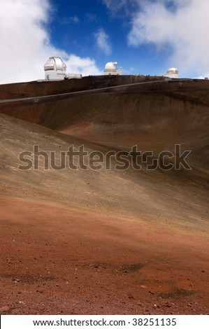 High altitude telescopes and astronomy observatories atop the summit of Mauna Kea volcano, Big Island, Hawaii - stock photo