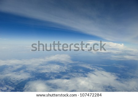 High altitude view of the atmosphere. Clouds and blue sky. - stock photo