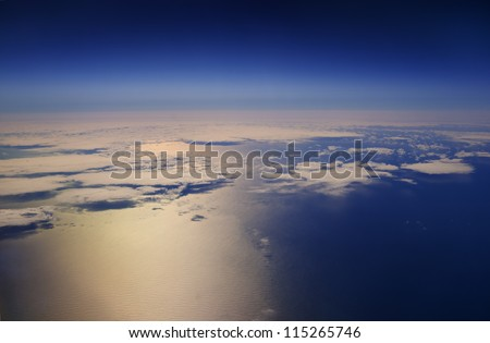 High altitude view of the atmosphere. Clouds over the ocean.